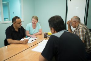 Sister Heather Stiverson helps unemployed refugees with their English skills.